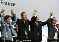 UNFCCC Executive Secretary Christiana Figueres; UN Secretary-General Ban Ki-moon; COP21 President Laurent Fabius, Foreign Minister, France; and France's President Francois Hollande celebrate the adoption of the Paris Agreement, December 12, 2015.