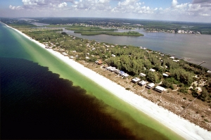 Karenia brevis, also known as red tide, just off the coast of one of Florida's many Gulf front communities.