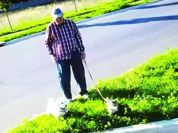 Richard Henderson  walking his dog Dudley and his cat Kit-Kat