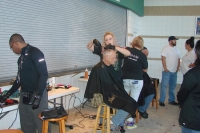 Lee County Homeless Coalition give haircuts to homeless vets at the 2015 Homeless Service Day