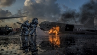 Marine Corps firefighters from Marine Wing Support Squadron 172 and Royal Thai Navy firefighters work together to extinguish an aircraft fire simulating a crash during aircraft extraction training at U-Tapao International Airport, Ban Chang district, Rayong province, Thailand, Feb. 20, 2018. The training was conducted as part of Exercise Cobra Gold 2018. Air Force photo by Staff Sgt. Micaiah Anthony