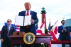 President Donald Trump shows off a memorandum on  protecting Florida, Georgia and South Carolina coastlines from offshore drilling after speaking on the environment  at Jupiter Inlet Lighthouse and Museum, in Jupiter, Fla
