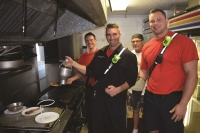 Members of the FMB Fire Control District on the grill.