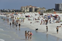 Visitors enjoy Clearwater Beach last week, in Clearwater Beach, Fla.