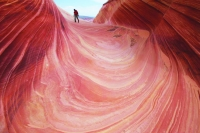 This May 28, 2013 file photo shows a on a tourist rock formation known as The Wave in the Vermilion Cliffs National Monument in Arizona.