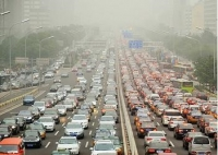 Beijing traffic emits polluting gases and particulates that cause smog.
