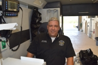 Captain Randy Kraus sits in one of the three new ambulances that were delivered to FMB Fire Control District Station 32 on August 11th. He is sitting in a forward-facing action seat, where he can reach both the patient and the equipment needed to aid them without getting up while the vehicle is in motion.